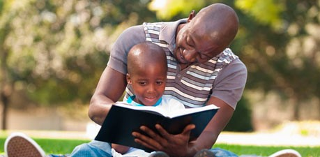 Father-reading-with-sonws